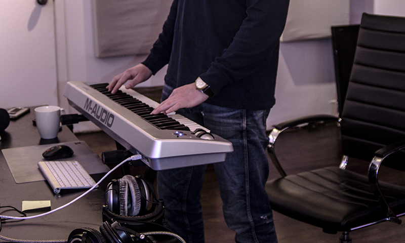 Vancouver producer DEO is seen working at his keyboard, presumably producing a beat.