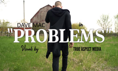 Screenshot of Dave Mac walking away from the camera in his video for the single Problems.