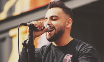 A photo of Calgary-singer Ruben Young holding a microphone and performing