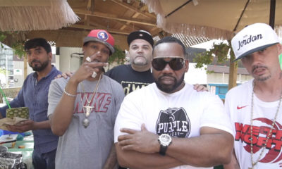 A screenshot from the Risk It All video featuring YH, Turk, and a cameo by Raekwon of Wu-Tang Clan.