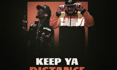 Artwork for the big ZEE single Keep Ya Distance which features Woopty Woop