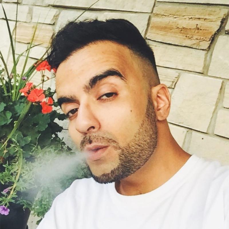 Photo of Toronto producer Vokab blowing smoke